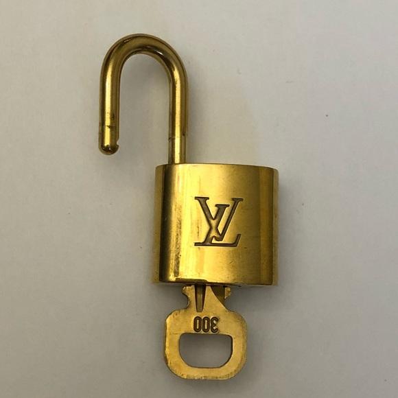 c61e52fea6e7 Louis Vuitton Accessories - authentic Louis Vuitton lock and key set 300